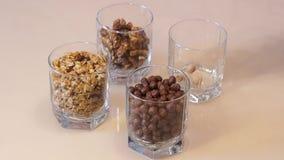 Mezcla de las nueces Pistachos nuez Tuercas clasificadas muesli Bolas del maíz del chocolate metrajes