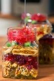 Mezcla y miel de los frutos secos Fotos de archivo libres de regalías