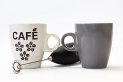 Mezclador de la batería y taza de café negros Imagen de archivo libre de regalías