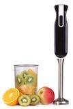 Mezclador de la mano y frutas frescas Imagen de archivo libre de regalías