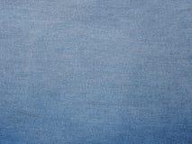 Mezclilla azul del dril de algodón imagenes de archivo