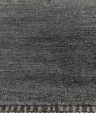 Mezclilla de la materia textil imagen de archivo