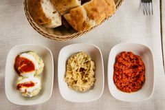 Meze small dishes on the table: hummus, Antep Ezmesi. Mezze is selection of small dishes served in the Near East, and parts of Central Asia. In Turkey meze is Royalty Free Stock Image