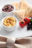 Meze with tomato, olives, and pita bread Royalty Free Stock Images