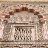 Mezquita, Cordoba. Cordoba, Spain. The Great Mosque (currently Catholic cathedral). UNESCO World Heritage Site. Mashrabiya window with stone latticework Stock Photography