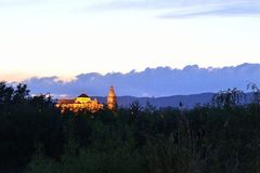 Mezquita de Córdoba. Panoramic image with tripod and timer of the Mosque of Cordoba and river vegetation stock photo