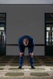 Mezquita humilde de Muslim Prayer In del hombre de negocios Imagen de archivo