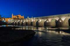 Mezquita and roman bridge Stock Images