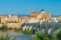 Mezquita and Roman bridge in Cordoba. Andalusia, Spain royalty free stock images