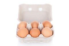 Mezza dozzine uova marroni del pollo Fotografia Stock