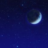 mezza luna blu con la stella al cielo notturno Fotografia Stock Libera da Diritti