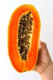 Mezza papaia a disposizione Fotografia Stock Libera da Diritti