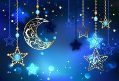 Mezzaluna dell'oro su fondo blu fotografia stock libera da diritti