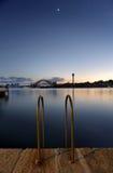 Mezzaluna over Sydney Harbour Bridge at twilight Royalty Free Stock Image
