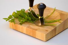 Mezzaluna and parsley Royalty Free Stock Photos