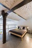 Mezzanine bedroom in industrial style idea stock image