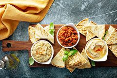 Mezze board with pita and dips. Mediterranean mezze board with pita and dips royalty free stock images