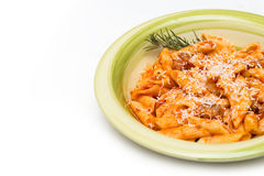 Mezze penne with pork meat and tomato sauce Stock Images