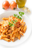 Mezze penne with pork meat and tomato sauce Royalty Free Stock Image