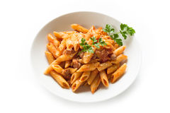 Mezze penne with pork meat and tomato sauce Royalty Free Stock Photo