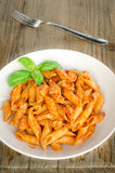 Mezze penne with ragout Stock Images
