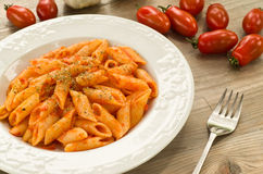 Mezze penne with tomato sauce and oregano Royalty Free Stock Photo