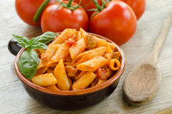 Mezze penne with tomato sauce and pork sausage Stock Photo