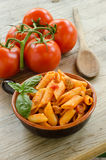 Mezze penne with tomato sauce and pork sausage Royalty Free Stock Photo