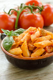 Mezze penne with tomato sauce and pork sausage Stock Photos