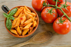 Mezze penne with tomato sauce and pork sausage Royalty Free Stock Photos