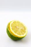 Mezzi limetta e limone della fetta Fotografie Stock