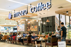 Mezzo Coffee, Bangkok, Thailand - August 5, 2017: Coffee shops in department stores sell expensive coffee. But most people choose Royalty Free Stock Photo