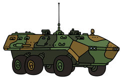 Mezzo corazzato per il trasporto delle truppe del cammuffamento Immagini Stock