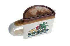 Mezzo tazza di caffè su bianco fotografia stock