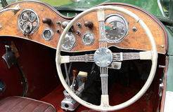 MG classic sports car. Interior detail of MG classic sports car with soft / open top showing steering wheel walnut dash board instruments and gear stick Stock Image