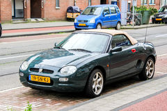 MG F. AMSTERDAM, NETHERLANDS - AUGUST 10, 2014: Motor car MG F at the city street Stock Image