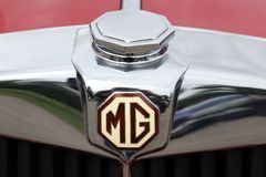 MG logo on a car. Dax, France - June 4, 2017: MG logo on a car. MG is an English automotive marque registered by the now defunct MG Car Company Limited, a Royalty Free Stock Photos
