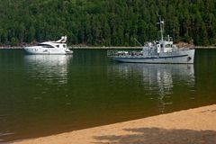 Two generations of small tourist vessels on Lake Baikal royalty free stock photos