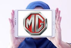 MG Motor company logo. Logo of MG Motor company on samsung tablet holded by arab muslim woman. MG Motor UK Limited MG Motor is an automotive company Royalty Free Stock Images