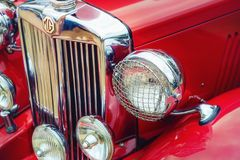 1951 MG TD Classic Car. Westlake, Texas - October 21, 2017: Closeup of headlights and the grille of a red 1951 MG TD classic car Stock Photos