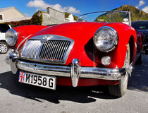 MG, Vintage Cars, Sports Cars. Vintage sports car- MG red coupe roadster, front view. Arrowtown, New Zealand Royalty Free Stock Images