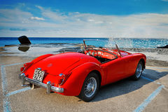 MGA 1500 British classic 2 door roadster 1960. Camogli, Italy - July 21, 2015: MGA 1500 Roadster, 1960 iconic British open-top classic 2-door roadster in vintage Royalty Free Stock Photo