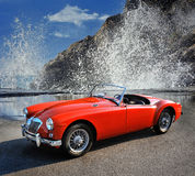 MGA 1500 British classic 2 door roadster 1960. Camogli, Italy - July 21, 2015: MGA 1500 Roadster, 1960 iconic British open-top classic 2-door roadster in vintage Royalty Free Stock Photos