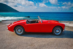 MGA 1500 British classic 2 door roadster 1960. Camogli, Italy - July 21, 2015: MGA 1500 Roadster, 1960 iconic British open-top classic 2-door roadster in vintage Royalty Free Stock Photography