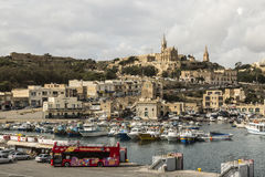 Mgarr harbour and town on Gozo, Malta. With churches on the hillside Stock Images