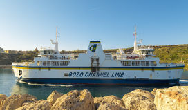 Mgarr, MALTA - APRIL 16: Ferry crosses the Gozo channel in Mgarr, Malta on  APRIL 16, 2015. The Gozo Channel Line operates the cro Royalty Free Stock Photos