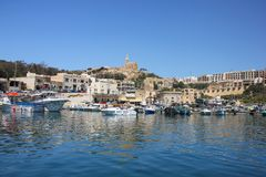 Mgarr, Malta - May 2018: Gozo Ferry Terminal view Mgarr. Bay with yachts on foreground and old city with church on the top on back stock image