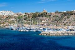 Mgarr, Malta - May 8, 2017: Mgarr Harbour at Gozo Island from the ferry. Mgarr, Malta - May 8, 2017: Mgarr Harbour at Gozo Island from the ferry Royalty Free Stock Image
