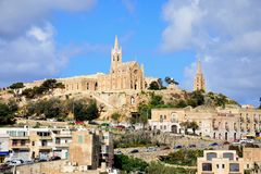 Mgarr town and church, Gozo. View of the town buildings with the Ghajnsielem Parish church and Our lady of Lourdes church to the rear, Mgarr, Gozo, Malta Stock Photography