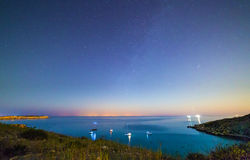 Mgiebah Bay at Night. Long exposure of Mgiebah Bay in Malta on a clear summer night. Street lights from Sicily can be clearly seen in the background on the stock image